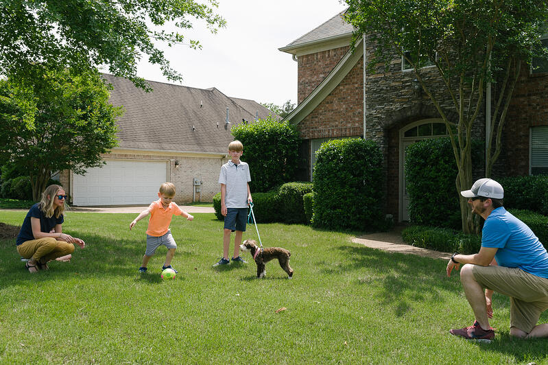 Happy family in lawn with mosquito control services