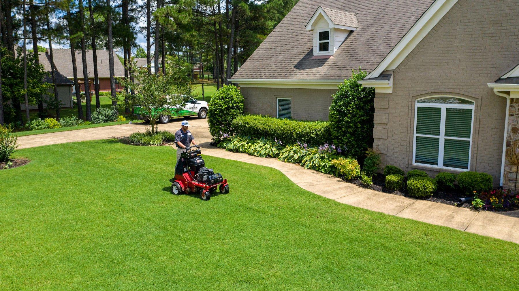 lawn care technician aerating