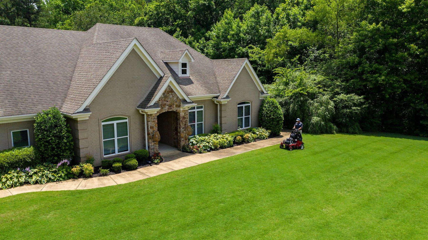Master Lawn lawn care technician aerating lawn in Memphis, TN