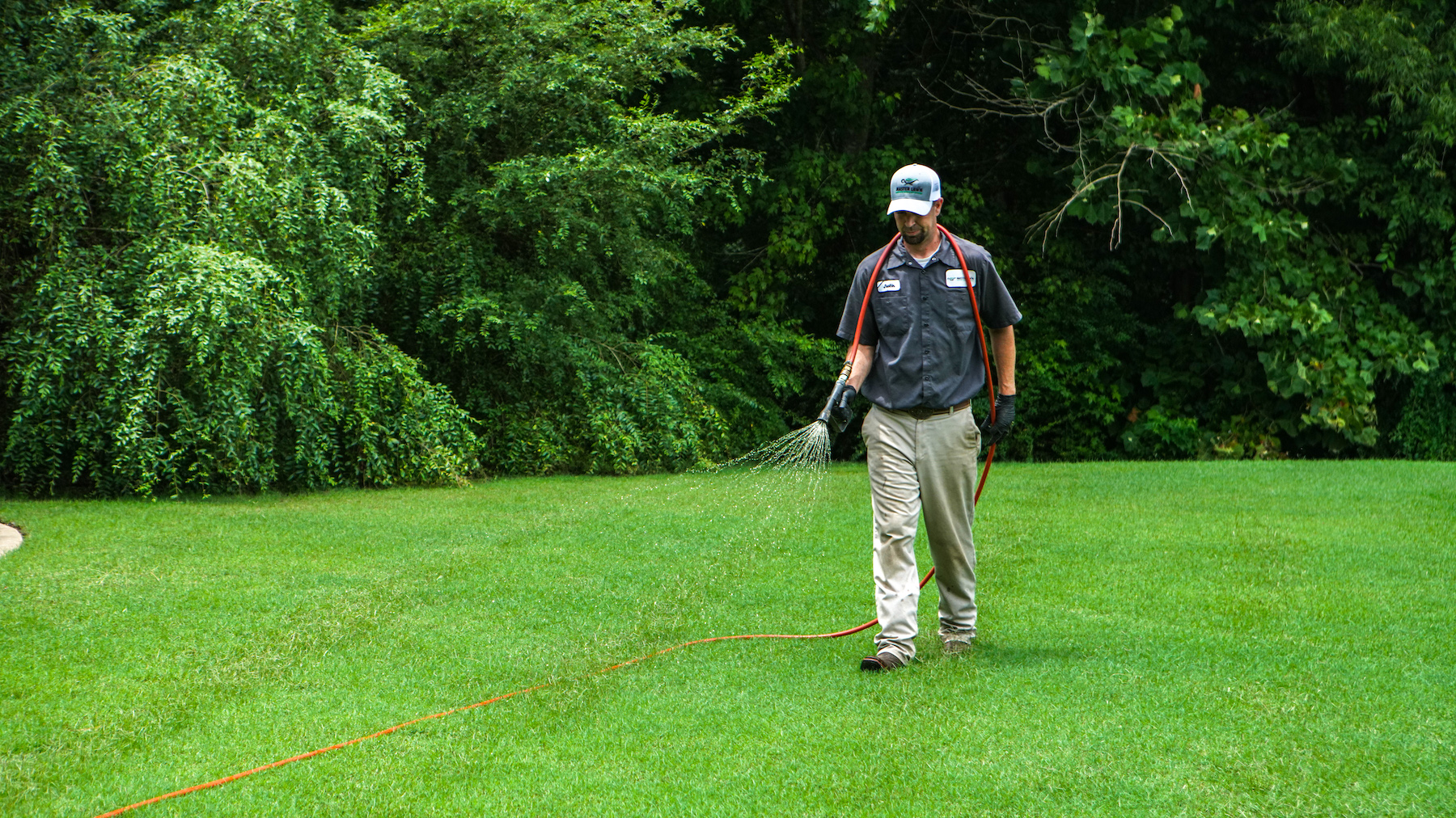 lawn care technician spraying
