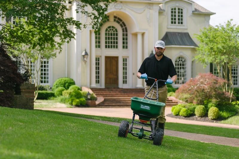 Master Lawn lawn care technician applying fertilizer