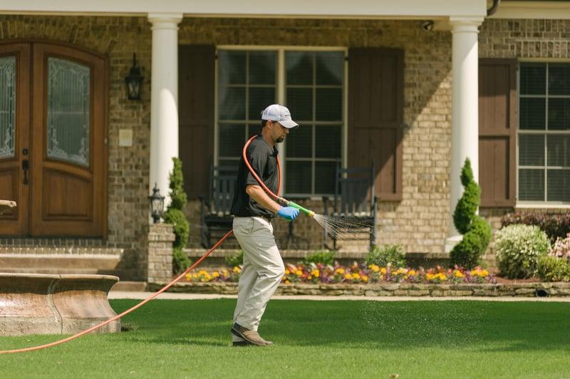 Master Lawn lawn care technician spraying lawn