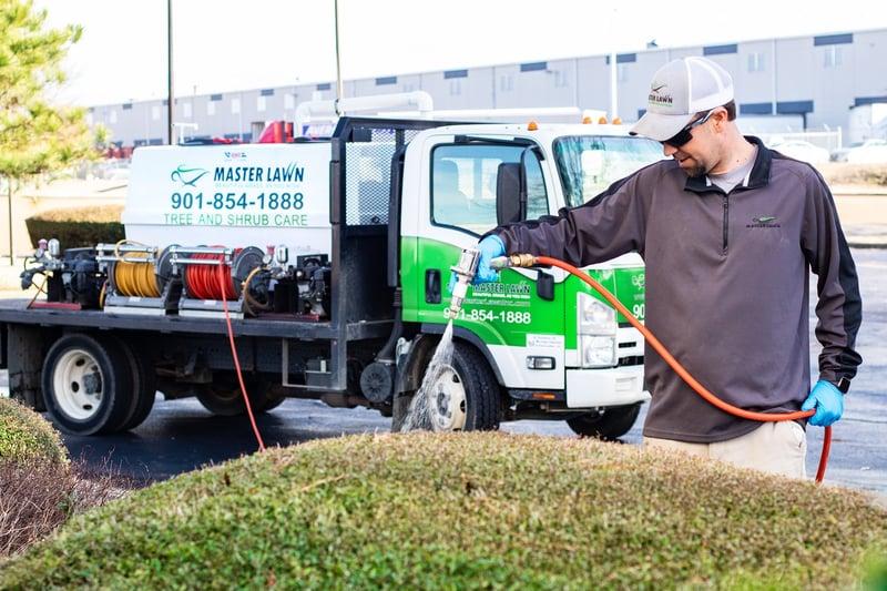 technician-spraying-shrubs-truck-1