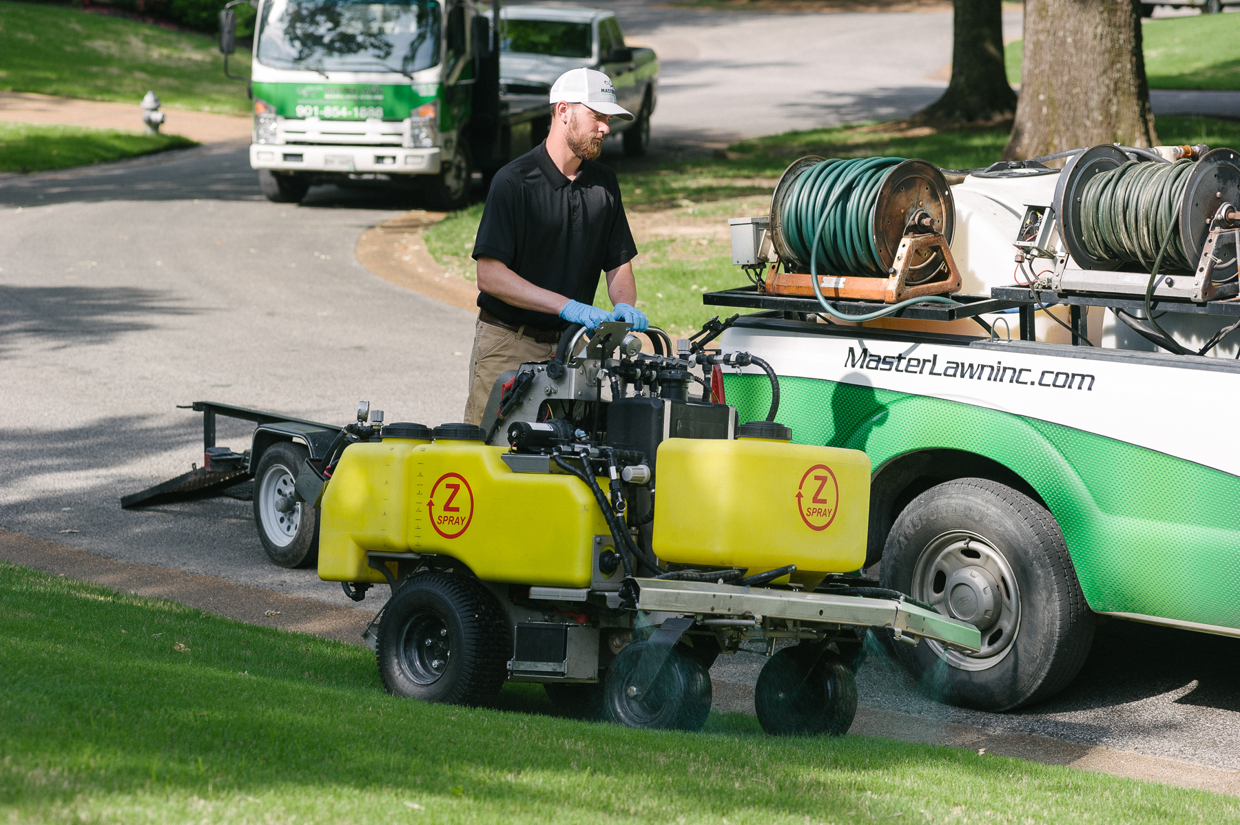 Master Lawn lawn care technician spraying lawn in Olive Branch, MS