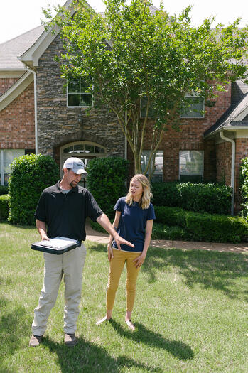 lawn care technician providing advice