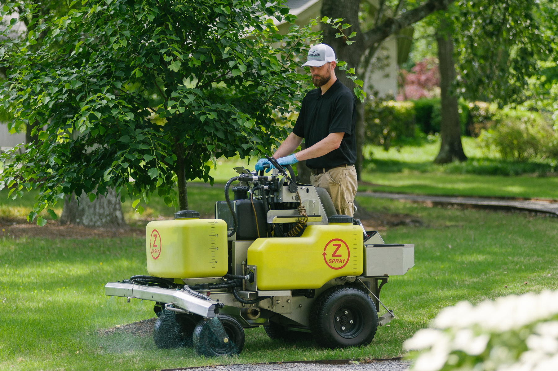 lawn technician spraying weed control